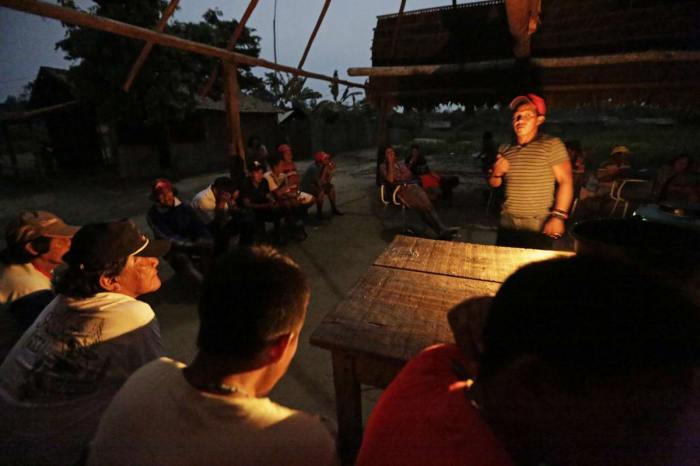Ka'apor Indian warriors hold a meeting the night before they begin an operation to search for and expel loggers from the Alto Turiacu Indian territory, in the village of Waxiguy Renda near the Centro do Guilherme municipality in the northeast of Maranhao state in the Amazon basin.